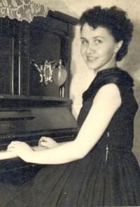 With her beloved piano