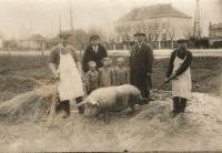On the left, Father Štěpán Bešta at the Dubni slaughterhouse