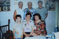 In the middle of the cave, cousin Alois Bešta with his family, who moved to exile after a lifetime in Novosibirsk