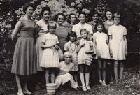 Marie Vegrichtová (4th from the left in top row; her mother towards her left; her sister towards her right), Krnov 1964