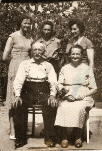 Marie (middle) with he sisters and parents