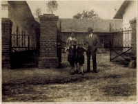 Horký family farm in the middle of village, courtyard gate, photo from 1930s