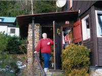 His wife Irena at their cottage in Šumava