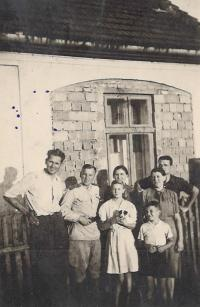 1945 (June) - Aloisie with parents and the Russian soldiers, who lived in their household