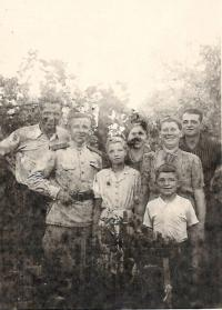 1945 (August) - Aloisie with parents and the Russian soldiers, who lived in their household