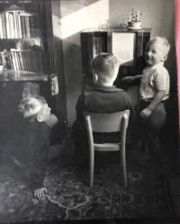 Left Jiří, Karel and Petr listening to a radio fairy tale, Prague about 1954