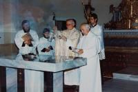 The consecrating of the repaired church in Domašov nad Bystřicí, bishop Josef Hrdlička before the altar and, on his left, the witness, Antonín Pospíšil, who repaired this church and was a priest in 1992-2005.
