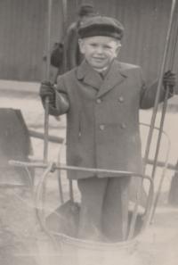 Petr Pavlík on a swing, Náměstí Jiřího Square, Prague 1947