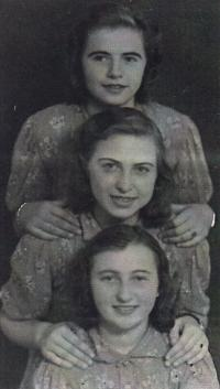 Emilie (below) with her friends, undated