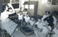 Eva Tauss (Chava Drachmann-Doron) working with disabled children. 1964.